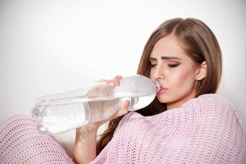 Beautiful sick woman drinking water