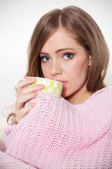 Beautiful ill woman drinking hot tea