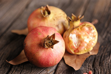 Ripe pomegranate on wooden background