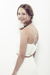 Portrait of beautiful young woman in white, smiling