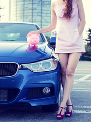 Woman car piggy bank corporate office dealership background