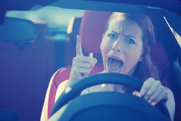 angry aggressive woman driving car screaming