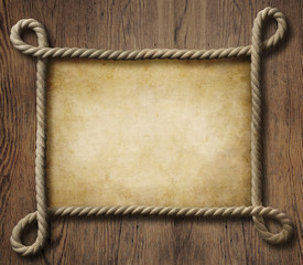 Pirate theme nautical rope frame with old paper background