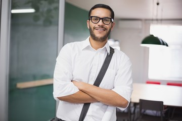 Casual businessman smiling at camera