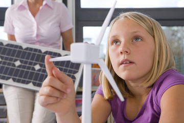 Curious student studying about wind turbines in school classroom