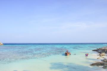 Fisherman sailed longtail boat on the beach - Lipe island Thaila