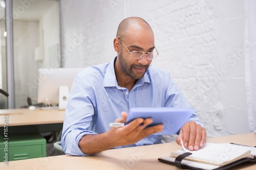 canvas print picture Businessman using digital tablet and diary at desk
