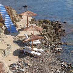 Greece, Tinos island, blue stairs to tranquil beach