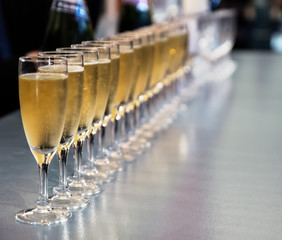 Row of full champagne glasses
