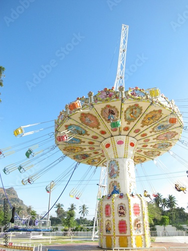 canvas print picture Chain swing ride in theme park.