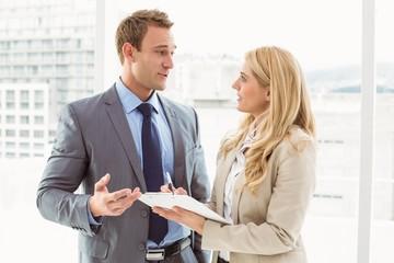 Businessman talking to his secretary