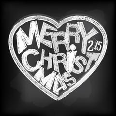 Happy holidays chalk heart shape message at blackboard