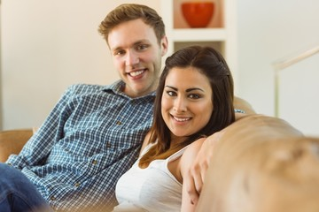 Happy young couple relaxing on the couch
