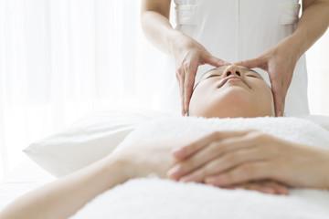 Women undergoing facial massage