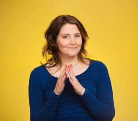 sly, scheming woman isolated on yellow background