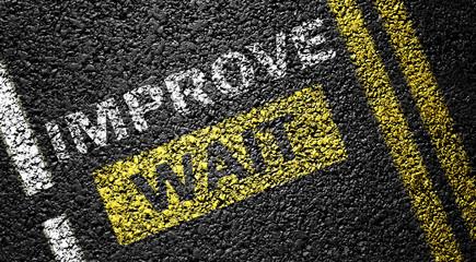 improve and wait symbol on thr road