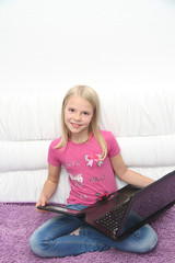 Little girl with her laptop at home