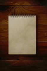Open Notepad on Dark Wood