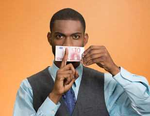 Headshot bribery man money cover mouth on orange background