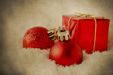 Red Christmas Decorations in Snow - Vintage Grunge