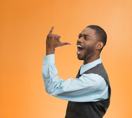 man gesturing lets go party drink isolated on orange background