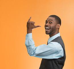man gesturing lets go party drink on orange background