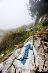 Blue arrow hiking and trekking symbol