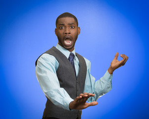 shocked scared business man screaming on blue background