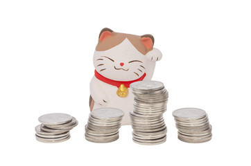 Japan lucky cat with stack of coin isolated on white