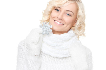 Beautiful young blond woman with snowflake
