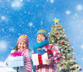 Children Enjoying Their Christmas Presents