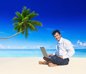 Businessman Working on the Beach