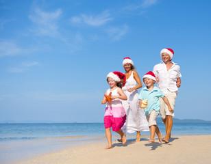 Family Having Fun on the Beach on Christmas