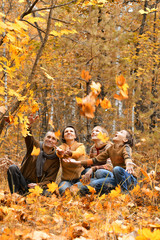 four in autumn forest