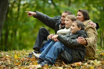 Family resting in park