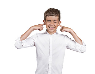 annoyed young man plugging closing ears on white background