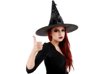 "Portrait of young witch shows gesture ""OK"" over white background"