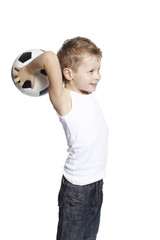 Young boy holding soccer ball, studio
