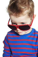 Close up of cool young boy in sunglasses, studio