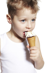 Young boy enjoying ice cream, close up