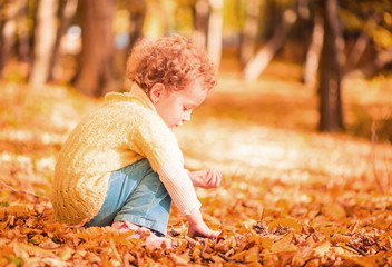 girl playing at fallen leafs