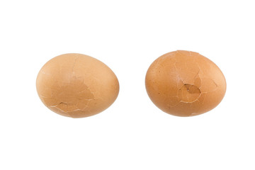 Cracked eggs on white background