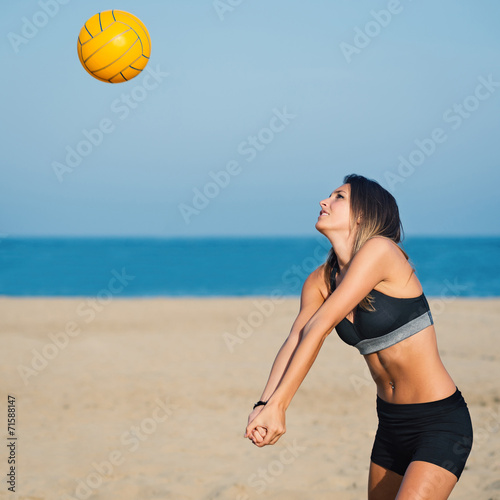 Attractive beach volleyball female player receiving ball. Poster