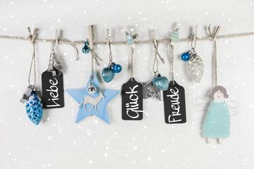 Weihnachtskarte in weiß und hellblau mit Text.