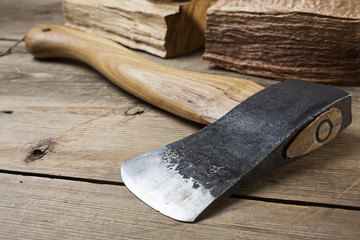 Wooden handle axe lying on wooden table