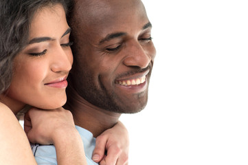 pretty woman hugging man and smiling on white background.