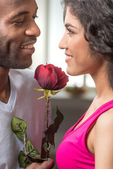 Man offering rose to his pretty girlfriend.