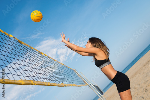 Jumping beach volleyball female player portrait. Tableau sur Toile