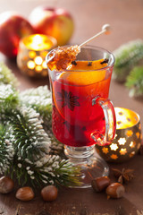 glass of mulled wine with orange and spices, christmas decoratio