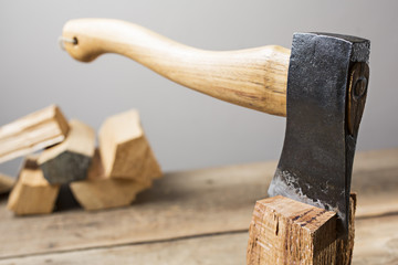 Old wooden handle axe in a block of wood